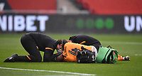 8th July 2020; Ashton Gate Stadium, Bristol, England; English Football League Championship Football, Bristol City versus Hull City; Jordy de Wijs of Hull City receives treatment after a clash of heads