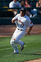 Rochester Red Wings third baseman Doug Bernier (17) rounds third on his way to score a run during a game against the Indianapolis Indians on June 10, 2015 at Frontier Field in Rochester, New York.  Indianapolis defeated Rochester 5-3.  (Mike Janes/Four Seam Images)