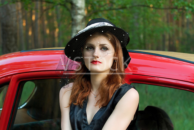 Woman with antique car