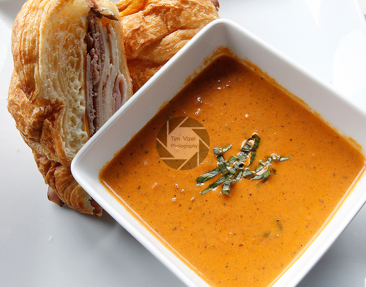 Tomato basil soup with a club sandwich.