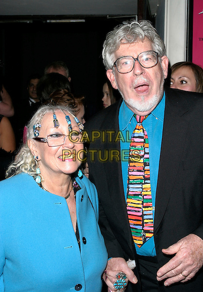 "ALWEN HUGHES & ROLF HARRIS.At the World Premiere of  ""Dirty Dancing: The Classic Story On Stage"", Aldwych Theatre, London, England, .October 24th 2006..half length married husband wife striped tie blue coat shirt beads braids in hair beaded.Ref: AH.www.capitalpictures.com.sales@capitalpictures.com.©Adam Houghton/Capital Pictures."