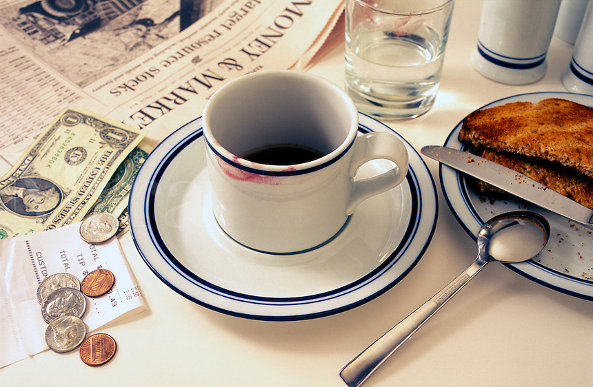 Coffee and toast, breakfast in restaurant/diner with newspape