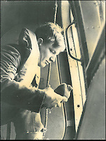 BNPS.co.uk (01202 558833).Pic: StewartWardrope/BNPS..***Please use full byline***..Pigeon release from a Catalina flying boat...Valuable bravery medals awarded to a flock of wartime homing pigeons have come to light to reveal the ingenious ways the British went about spying on the enemy...The birds were strapped in mini-parachutes and placed in small crates that were dropped behind enemy lines in order for the French Resistance to use...A corkscrew fan on the wooden crate unwound in the wind leading to the door to open.automatically in mid-air, allowing the pigeon to drop to the ground...The French attached coded messages about German military movements to the birds which flew across the English Channel with the precious intelligence...But one chilling note that has emerged after 70 years was written in German and informed the British the French recipient had been shot for spying having been found with a pigeon...Some 32 racing pigeons were awarded the prestigious Dickin Medal - the animal version of the Victoria Cross - for their acts of heroism in World War Two...The Royal Pigeon Racing Association owns five of them. Its general manager, Stewart Wardrope, took them along to the BBC's Antiques Roadshow to show them off...He also revealed the stories behind their award as well some of the other madcap inventions made by British boffins and used to gather intelligence using the birds...These included a clockwork camera strapped to the belly of a pigeon that automatically took reconaissance snaps of Nazi-occupied Europe before returning home...Of the five medals due to be featured on this Sunday's Antiques Roadshow, two were awarded to pigeons that delivered important intelligence from Europe six times between them...Another, named 'Beachcomber', brought back the first news of the disastrous landings at Dieppe in September 1942.