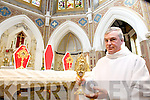 Fr. Joe Bulman with a relic containing the blood of St, Faustina with relics of Popes John Paul II and Pope John XXIII on the alter, the relics are going on permenent display on the church.