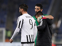 Calcio, Serie A: Lazio vs Juventus. Roma, stadio Olimpico, 4 dicembre 2015.<br /> Juventus&rsquo; players, from left, Alvaro Morata, Gianluigi Buffon and Paulo Dybala celebrate at the end of the Italian Serie A football match between Lazio and Juventus at Rome's Olympic stadium, 4 December 2015. Juventus won 2-0.<br /> UPDATE IMAGES PRESS/Isabella Bonotto