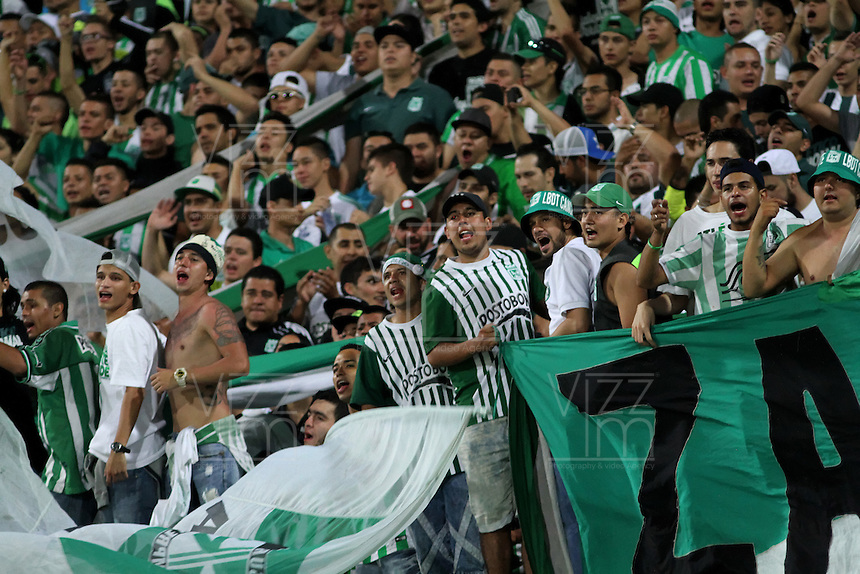 MEDELLÍN -COLOMBIA-20-12-2015. Hinchas  del Atlético Nacional  aleinetan a su equipo durante su encuentro contra el Junior  partido de vuelta de la final de la Liga Aguila II 2015 entre Atlético Nacional y Atlético Junior jugado en el estadio Atanasio Girardot de la ciudad de Medellín. / Fans  of Atletico Nacional cheer their team agianst of Atlético Junior during second leg match of the final of Aguila League II 2015 between Atletico Nacional and Atletico Junior played at Atanasio Girardot stadium in Medellin city. Photo: VizzorImage/ Felipe Caicedo / Staff