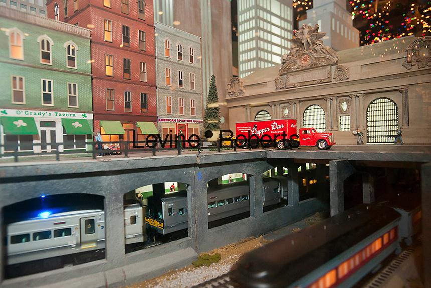 "NYC Transit Museum in Grand Central Terminal in New York 10th Annual Holiday Train Show on Tuesday, November 15, 2011. The ""O gauge"" Lionel model train rolling stock travels a 34-foot -long route on eight separate loops of track. The trains pass a model Grand Central Terminal along their journey which takes them from the North Pole to suburbs to the heart of Manhattan. (© Richard B. Levine)"
