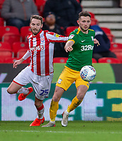 12th February 2020; Bet365 Stadium, Stoke, Staffordshire, England; English Championship Football, Stoke City versus Preston North End; Alan Browne of Preston North End under pressure from Nick Powell of Stoke City