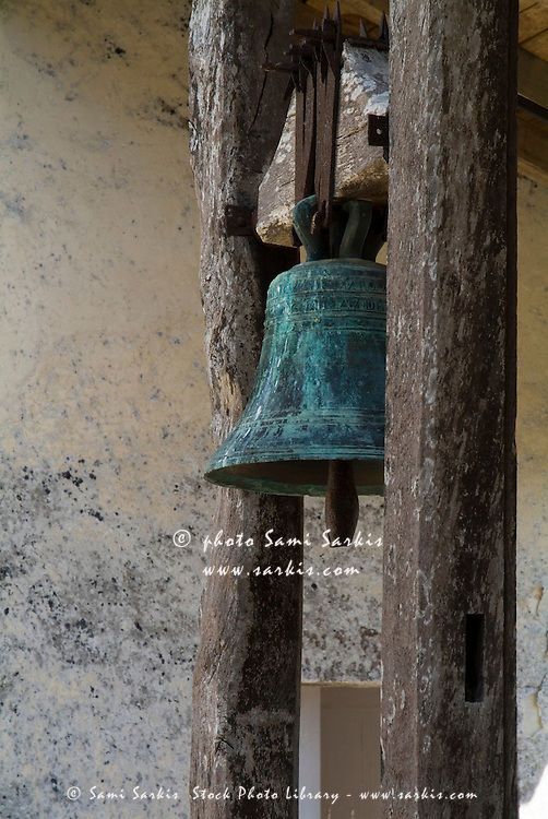Old bronze bell in a castle at Cazeneuve, Aquitane, France.