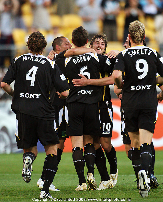 Phoenix players congratulate Tim Brown on his equaliser during the A-League football match between Wellington Phoenix and Melbourne Victory at Westpac Stadium, Wellington, New Zealand on Friday, 28 November 2008. Photo: Dave Lintott / lintottphoto.co.nz