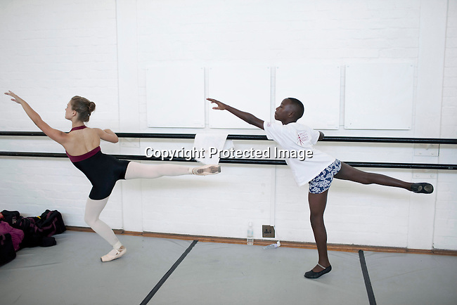 CAPE TOWN, SOUTH AFRICA - MARCH 6: Sikhumbuzo Hlahleni (center), age 15, trains with other students at Cape Town City Ballet's youth company on March 6, 2010 in Cape Town, South Africa. He trains in Cape Town every Saturday. He also trains a few days week at home in Khayelitsha, a poor township outside Cape Town. (Photo by Per-Anders Pettersson)