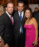 Inaki Drozco,center, with Jeff and Ericka Bagwell at the Una Notte in Italia dinner and fashion show at the InterContinental Hotel Friday Nov. 07, 2008. (Dave Rossman/For the Chronicle)