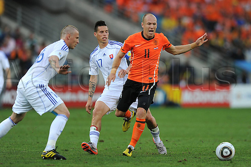 28 06 2010    Arjen Robben of The Netherlands challenges with A Slovakia Player during The 2010 World Cup Round of 16 Soccer Match AT Moses Mabhida stadium in Durban South Africa