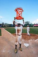 Taylor Trammell (5) of Mt. Paran Christian High School in Powder Springs, Georgia raises the Gatorade G Award above his after the Under Armour All-American Game on August 15, 2015 at Wrigley Field in Chicago, Illinois. (Mike Janes/Four Seam Images)