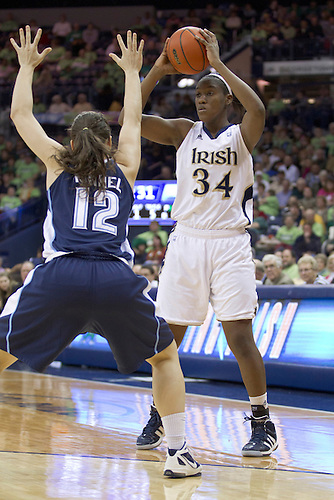 Notre Dame forward Markisha Wright (#34) looks to pass the ball as Villanova guard Lindsay Kimmel (#12) defends in second half action of NCAA Women's basketball game between Villanova and Notre Dame.  The Notre Dame Fighting Irish defeated the Villanova Wildcats 76-43 in game at Purcell Pavilion at the Joyce Center in South Bend, Indiana.