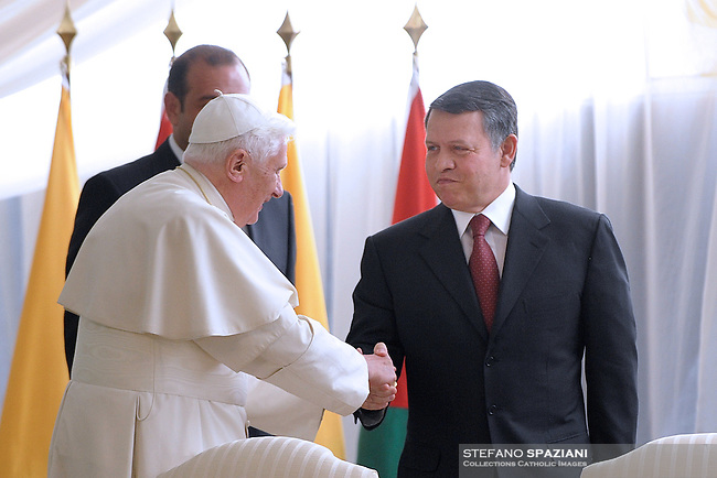 King Abdullah II of Jordan, greets Pope Benedict XVI, on pope's arrival in Amman, Jordan Friday, May 8, 2009..