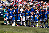 CHICAGO, IL - OCTOBER 6: Player escorts stand in front of the USWNT during a game between Korea Republic and USWNT at Soldier Field on October 6, 2019 in Chicago, Illinois.