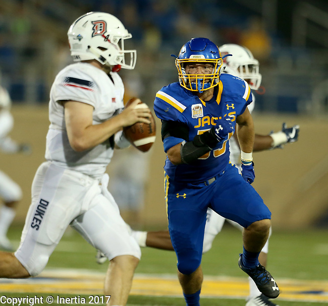 BROOKINGS, SD - AUGUST 31: Dalton Cox #53 from South Dakota State University has quarterback Tommy Stuart #6 from Duquesne in his sights in the first half of their game Thursday night at Dana J. Dykhouse Stadium in Brookings. (Photo by Dave Eggen/Inertia)