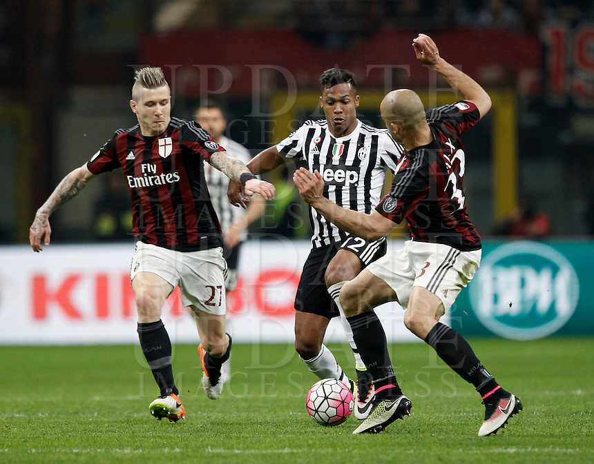 Calcio, Serie A: Milan vs Juventus. Milano, stadio San Siro, 9 aprile 2016. <br /> Juventus&rsquo; Alex Sandro, center, is challenged by AC Milan&rsquo;s Juraj Kucka, left, and Alex, during the Italian Serie A football match between AC Milan and Juventus at Milan's San Siro stadium, 9 April 2016.<br /> UPDATE IMAGES PRESS/Isabella Bonotto