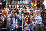 "© Joel Goodman - 07973 332324 . 23/08/2014 .  Manchester , UK . Faces in the crowd . The parade through Manchester City Centre . Manchester Pride "" Big Weekend "" in Manchester "" today ( 23rd August 2014 ) . Photo credit : Joel Goodman"