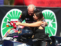 Oct 14, 2019; Concord, NC, USA; NHRA pro stock motorcycle rider Jianna Salinas with crew during the Carolina Nationals at zMax Dragway. Mandatory Credit: Mark J. Rebilas-USA TODAY Sports