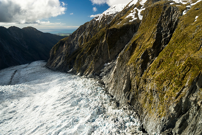 Downstream view into valley across crevasses on Franz Josef Glacier and toward Tasman Sea on horizon, Westland Tai Poutini National Park, West Coast, UNESCO World Heritage Area, New Zealand, NZ