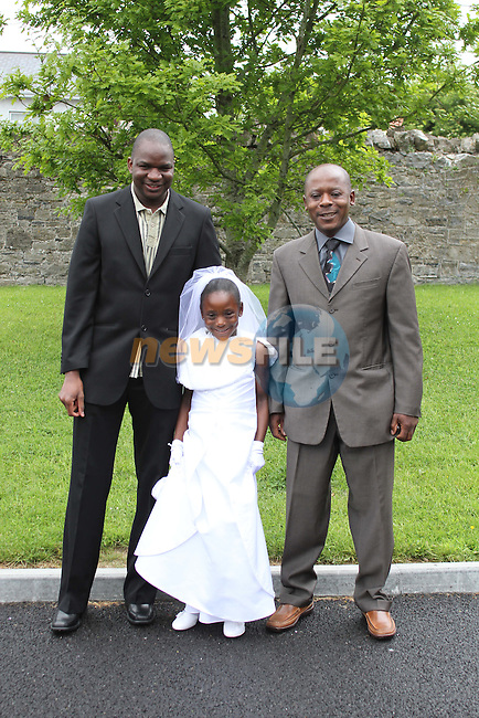 Tinaye Benhura with Noel and Robert at Slane NS Communion...(Photo credit should read Jenny Matthews www.newsfile.ie)....This Picture has been sent you under the conditions enclosed by:.Newsfile Ltd..The Studio,.Millmount Abbey,.Drogheda,.Co Meath..Ireland..Tel: +353(0)41-9871240.Fax: +353(0)41-9871260.GSM: +353(0)86-2500958.email: pictures@newsfile.ie.www.newsfile.ie.