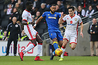 Liam Trotter of AFC Wimbledon (centre) under pressure from January transfer target George Williams of MK Dons (right) during the Sky Bet League 1 match between MK Dons and AFC Wimbledon at stadium:mk, Milton Keynes, England on 13 January 2018. Photo by David Horn.