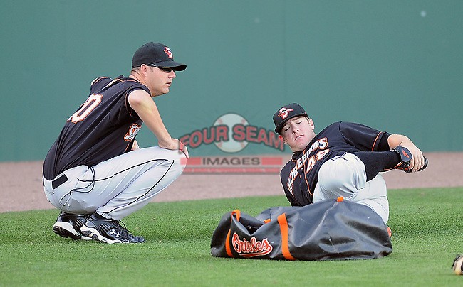 RHP Matt Hobgood (48) of the Delmarva Shorebirds, Class A affiliate of the Baltimore Orioles, stretches while talking with pitching coach Troy Mattes (20) prior to his first Class A start against the Greenville Drive April 10, 2010, at Fluor Field at the West End in Greenville, S.C. Hobgood was the Orioles' No. 1 pick (fifth overall) in the 2009 First-Year Player Draft. Photo by: Tom Priddy/MiLB.com