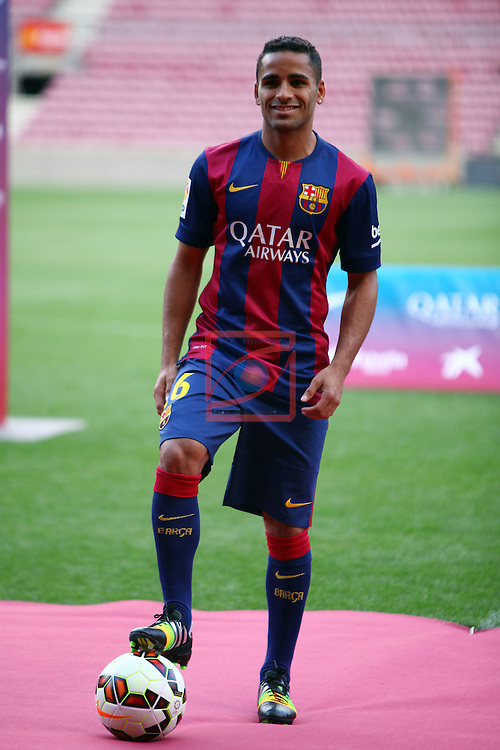 League BBVA 2014/2015.<br /> Douglas Pereira dos Santos new player of FC Barcelona.<br /> Douglas Pereira dos Santos poses during his presentation at the Camp Nou stadium.