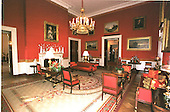 Washington, DC - December 4, 2000 -- Wide view of the Red Room, one of the three parlors on the State Floor at the White House in Washington, D.C. on December 4, 2000.  The traditional cranberry tree sits atop the most important piece of American Empire furniture in the White House collection, the marble-top center table made in New York around 1810 by Charles-Honore Lannuier.  The table is in the center right of the photo. .Credit: Ron Sachs - CNP