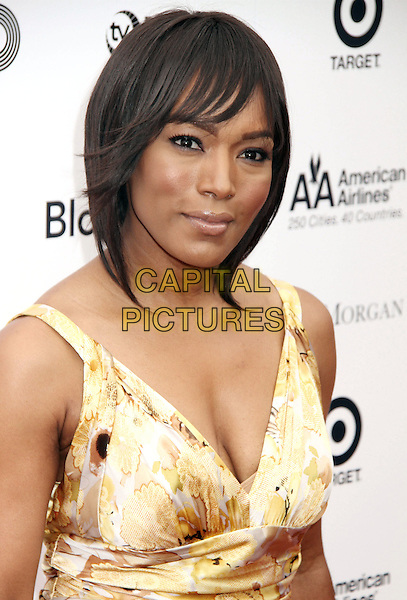 ANGELA BASSETT.2010 Apollo Theater Benefit Concert & Awards Ceremony held at The Apollo Theater, New York, NY, USA, .14th June 2010..portrait headshot gold yellow print fringe .CAP/ADM/AC.©Alex Cole/AdMedia/Capital Pictures.