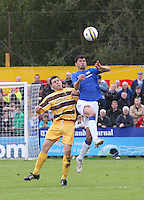 Emilson Cribari  wins the aerial ball from Scott Lawrie in the Forres Mechanics v Rangers William Hill Scottish Cup 2nd Round match, at Mosset Park, Forres on 29.9.12.