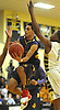 Angel Jimenez #23 of Central Islip makes an acrobatic move to get off a shot during the fourth quarter of a non-league varsity boys basketball game against Elmont in the Richard Brown Nassau-Suffolk Challenge at Uniondale High School on Saturday, Jan. 13, 2018. Central Islip won by a score of 63-56.