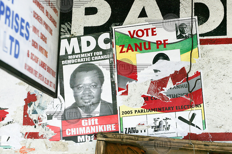 Election posters for the 2005 parliamentary elections depicting Gift Chimanikire for the Movement for Democratic Change (MDC) and Robert Mugabe for Zanu-PF (Zimbabwe African National Union - Patriotic Front).