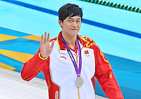 July 30, 2012..YANG SUN of CHN winner of men's 200m freestyle event waves at spectators at the Aquatics Center on day three of 2012 Olympic Games in London, United Kingdom...