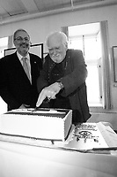 Montreal (Qc) CANADA - April 10 2012 File Photo - <br /> Pierre Arcand, Quebec Environment Minister (L) and Jacques Languirand (R) cut the cake for <br /> Earth Day - Jour de la Terre  - Pierre Arcand, Quebec  Minister of Environment, Sustainable Development and Parks and was previously the Minister of International Relations and for the Francophonie. - Pierre Arcand, Quebec  Minister of Environment, Sustainable Development and Parks and and Jacques Languirand celebrate Earth Day 2012