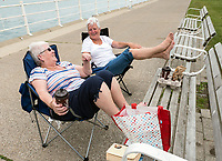 Yvonne Hay, left and Jean Jenkins, both born in Scotland and long time friends share memories while relaxing along the Centennial Park walk. The women both came to Canada in the early 70's and worked at Marshall Gowland Manor. The women spent a hot summer day cooling off, drinking coffee and reading.