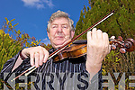 TUNING UP: Castleisland musician, Nicky McAuliffe who celebrates 40 years of teaching music in Kerry this year.