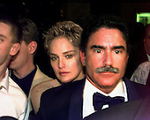 Sharon Stone peers over the shoulder of her husband, Phil Bronstein of the San Francisco Examiner, following  the White House Correspondents Dinner at the Washington Hilton Hotel in Washington, D.C. on April 25, 1998.  .Credit: Ron Sachs / CNP