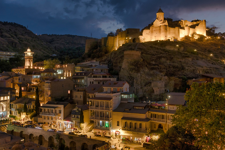 Narikala castle, Old Town, and the River Mtkvari are beautifully illuminated in the pre-dawn hours at Tbilisi.