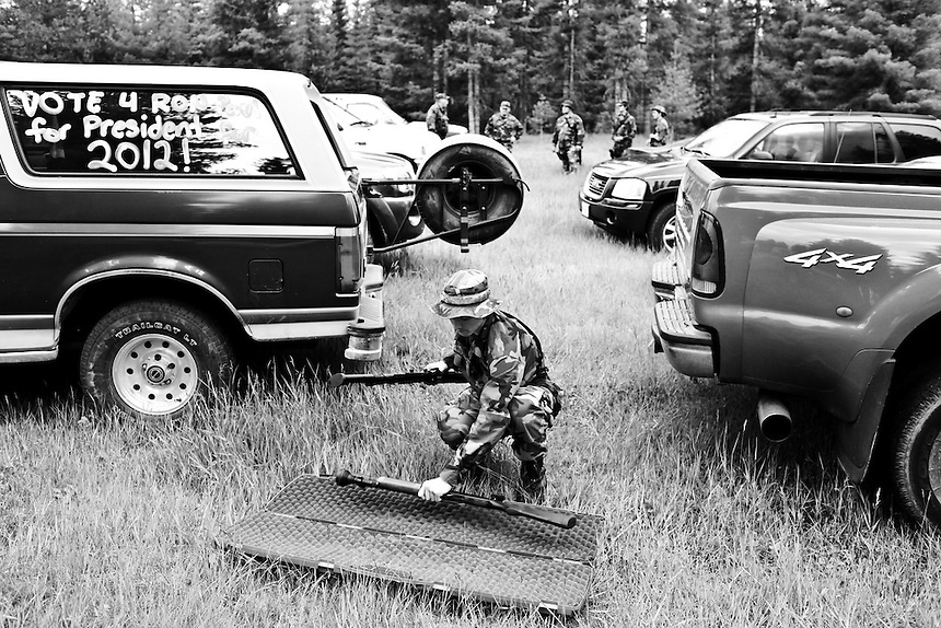 Charlie, a 16-year-old member of the Idaho Light Foot Militia from Couer d'Alene trades a shotgun for a rifle during a weekend-long training exercise at a camp near Priest Lake, Idaho.