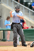 Home plate umpire Derek Eaton makes a call during a game between the Corpus Christi Hooks and NW Arkansas Naturals on May 26, 2014 at Arvest Ballpark in Springdale, Arkansas.  NW Arkansas defeated Corpus Christi 5-3.  (Mike Janes/Four Seam Images)