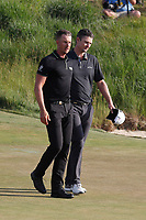 Henrik Stenson (SWE) and Justin Rose (ENG) finish on the 18th hole during the 118th U.S. Open Championship at Shinnecock Hills Golf Club in Southampton, NY, USA. 17th June 2018.<br /> Picture: Golffile | Brian Spurlock<br /> <br /> <br /> All photo usage must carry mandatory copyright credit (&copy; Golffile | Brian Spurlock)