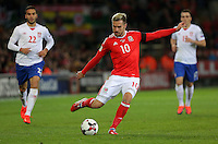 Aaron Ramsey of Wales cross the ball during the 2018 FIFA World Cup Qualifier between Wales and Serbia at the Cardiff City Stadium, Wales, UK. Saturday 12 November 2016