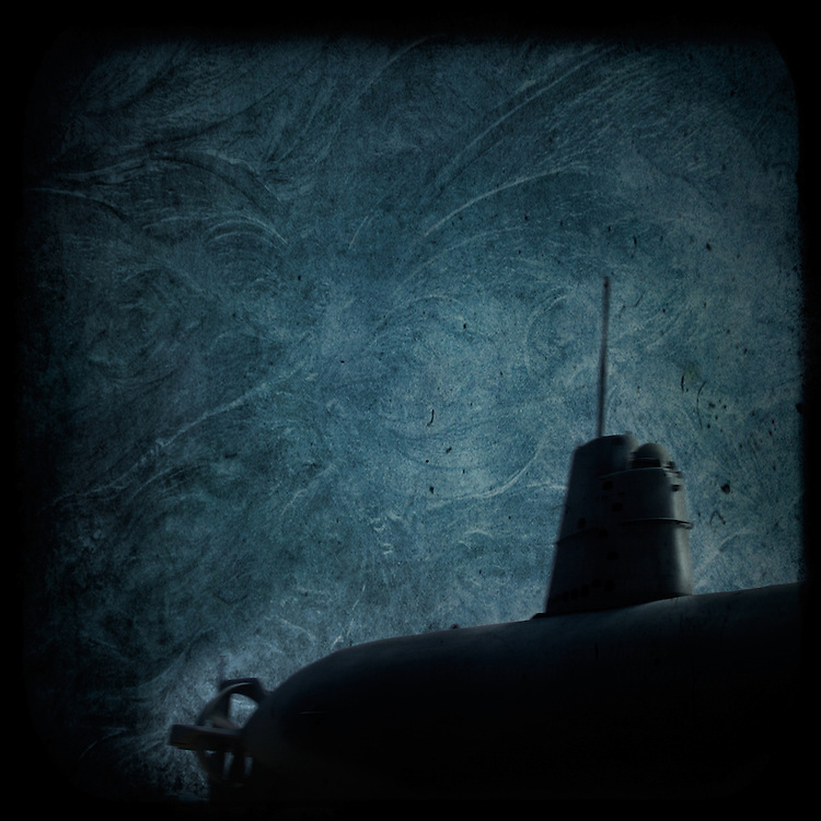A dark submarine under water with menace