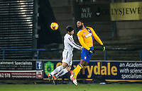Yoann Arquin of Mansfield Town clears from Joe Jacobson of Wycombe Wanderers during the The Checkatrade Trophy  Quarter Final match between Mansfield Town and Wycombe Wanderers at the One Call Stadium, Mansfield, England on 24 January 2017. Photo by Andy Rowland.