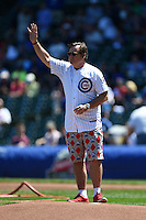 Actor Joel Murray acknowledges the crowd before throwing out a ceremonial first pitch before a Chicago Cubs game against the Milwaukee Brewers on August 14, 2014 at Wrigley Field in Chicago, Illinois.  Milwaukee defeated Chicago 6-2.  (Mike Janes/Four Seam Images)