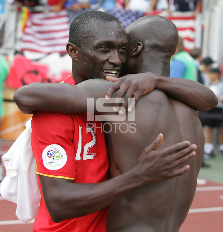 Ghananian teammates Alex Tachie-Mensah (12) and Stephen Appiah (10) celebrate their win. Ghana defeated the USA 2-1 in their FIFA World Cup Group E match at Franken-Stadion, Nuremberg, Germany, June 22, 2006. Ghana advances to round of 16 and the USA is out of the tournament.
