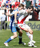 Rayo Vallecano's Roberto Trashorras (r) and Real Sociedad's Asier Illarramendi during La Liga match.April 14,2013. (ALTERPHOTOS/Acero)